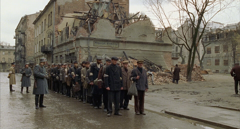 The Jewish workers within the ruins of the ghetto. Movie scene