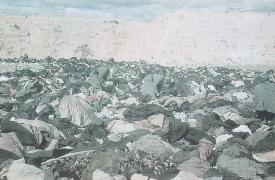 The SS soldiers ransack the belongings of the massacred Jews in the sands quarry in Babi yar