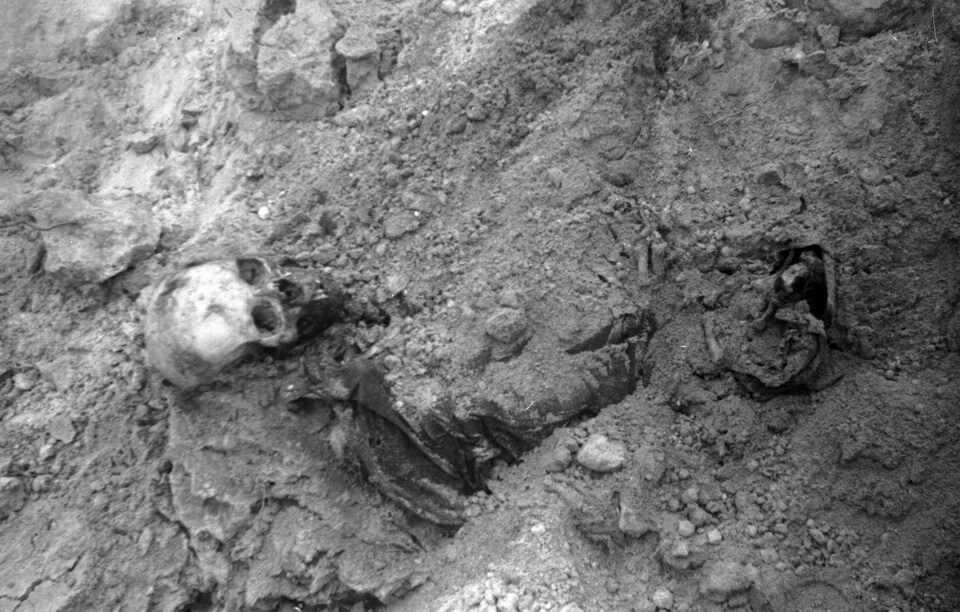 Human remains in a mass grave in Syrets camp next to Babi yar, 1943
