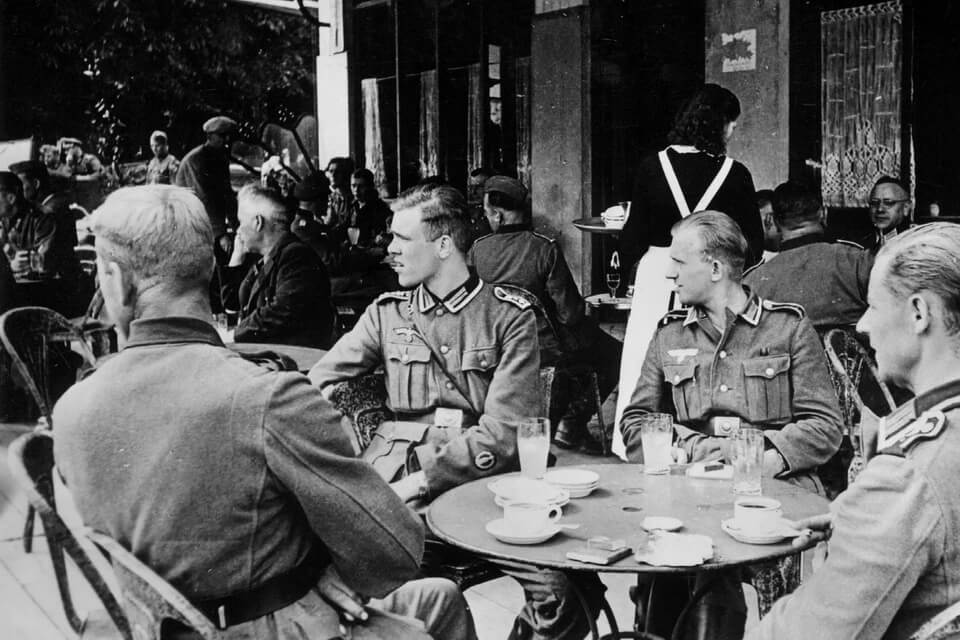 German unter officers in a street cafe of Paris