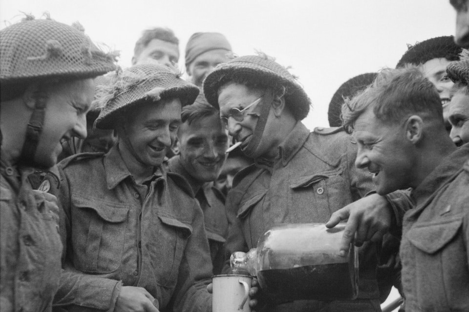 The soldiers of the 'Beach' Group shares rum on D-Day, June 6