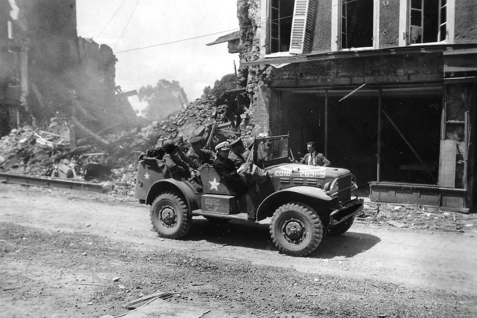 Generals Dwight Eisenhower on the streets of Isigny-Sur-Mer, June 12 1944