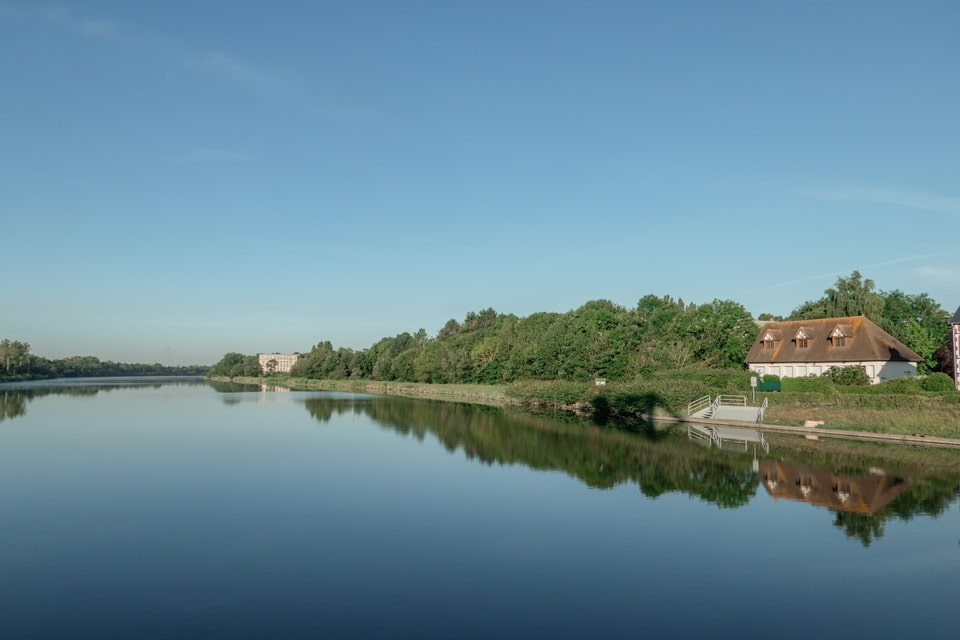 Caen canal and Chateau de Benouville in the far background