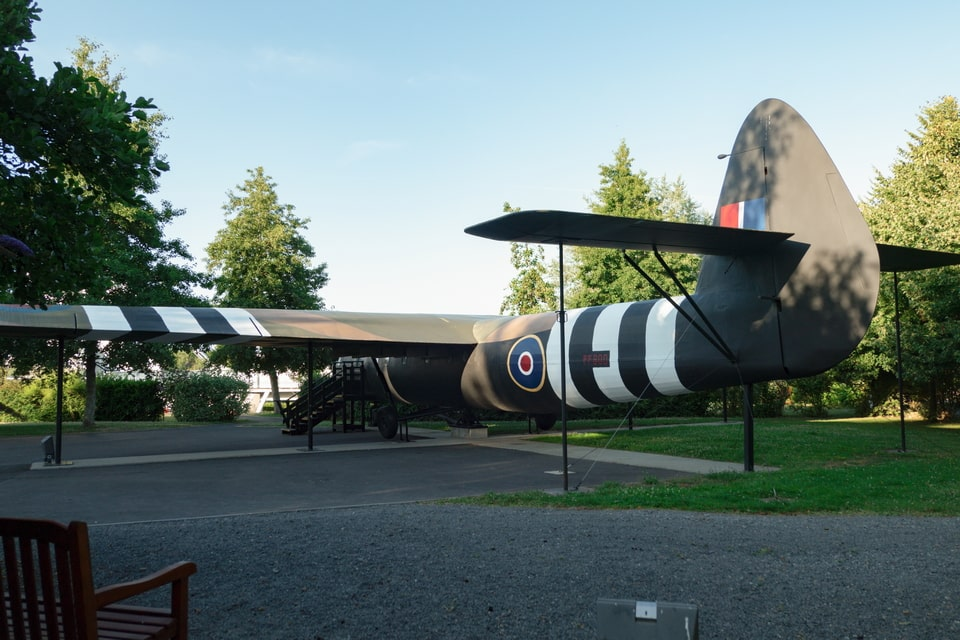 The replica of the Horsa glider within an open-air exposition in Benouville
