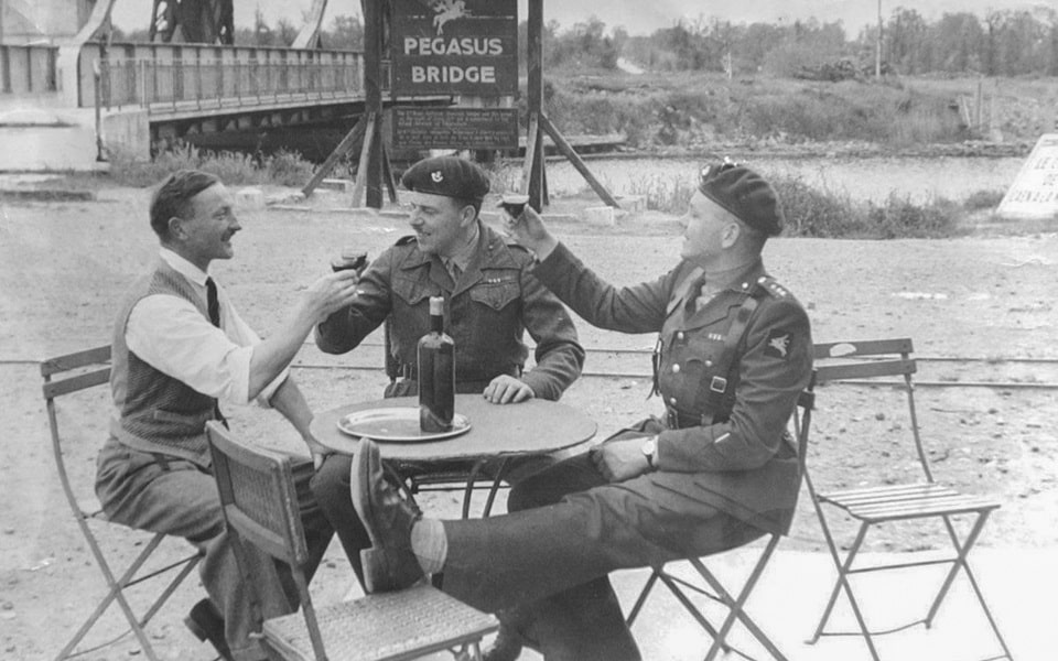 Georges Gondrée, Major John Howard, and Lieutenant David Wood near the cafe in 1946